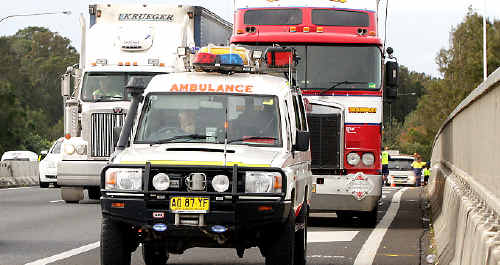 On scene: Paramedics at the scene of the accident on the Pacific Highway.
