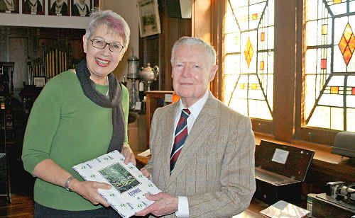 Mayor Jenny Dowell presents Dr Edward McWhinney with a gift at the Richmond River Historical Society's museum last week.