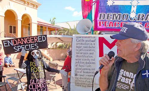 Outside the Lismore Court House, Graham Dustan supports activist Benny Zable, giving voice to concerns regarding his right to protest and subsequent arrest and treatment.