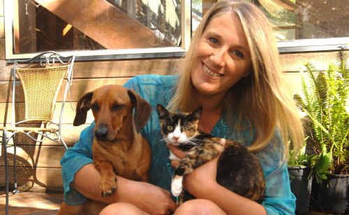 Wooloweyah's Deb Morris with Yogi the dachshund and Boo Boo the tabby who'll star in tonight's episode of Australia's Funniest Home Videos on NBN at 6.30pm.
