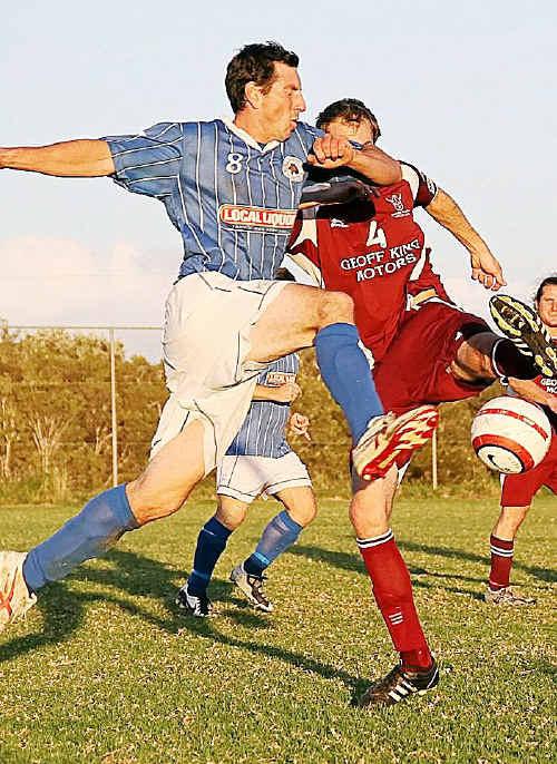 Woolgoolga's Anthony Baston and Urunga's Luke Pomroy fight for the ball.