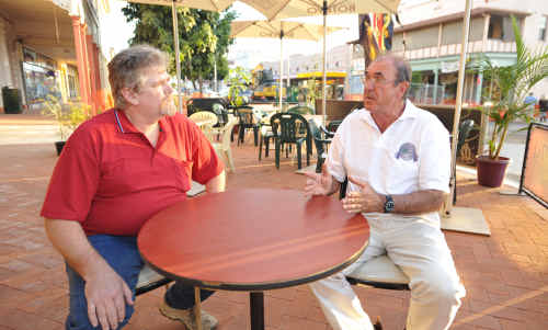 Grafton Chamber of Commerce's chief executive James Patterson and president Jeremy Challacombe discuss the proposed Outdoor Dining Policy over a coffee in Skinner Street, South Grafton, yesterday.