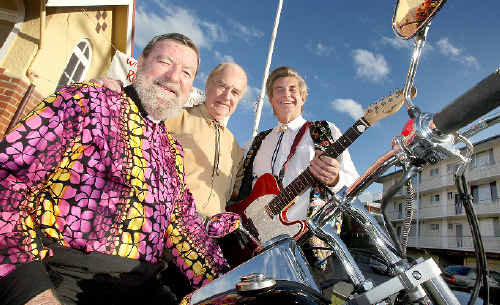 Colourful service: Reverend Ken Spreadbrough on the Laro 250 motorbike with rock singer Alan Dale and guitarist Ron Kitchin.