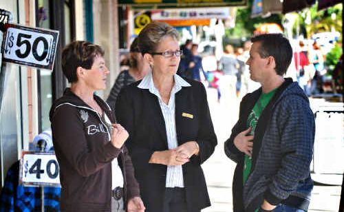 Not happy: Narelle Tilse, of Grafton Surf Co, Noel Smith of Low Pressure Surf Co and Carmell Sanne of Hope Chest talk about the effects of the weekend sale at the Grafton Showground.