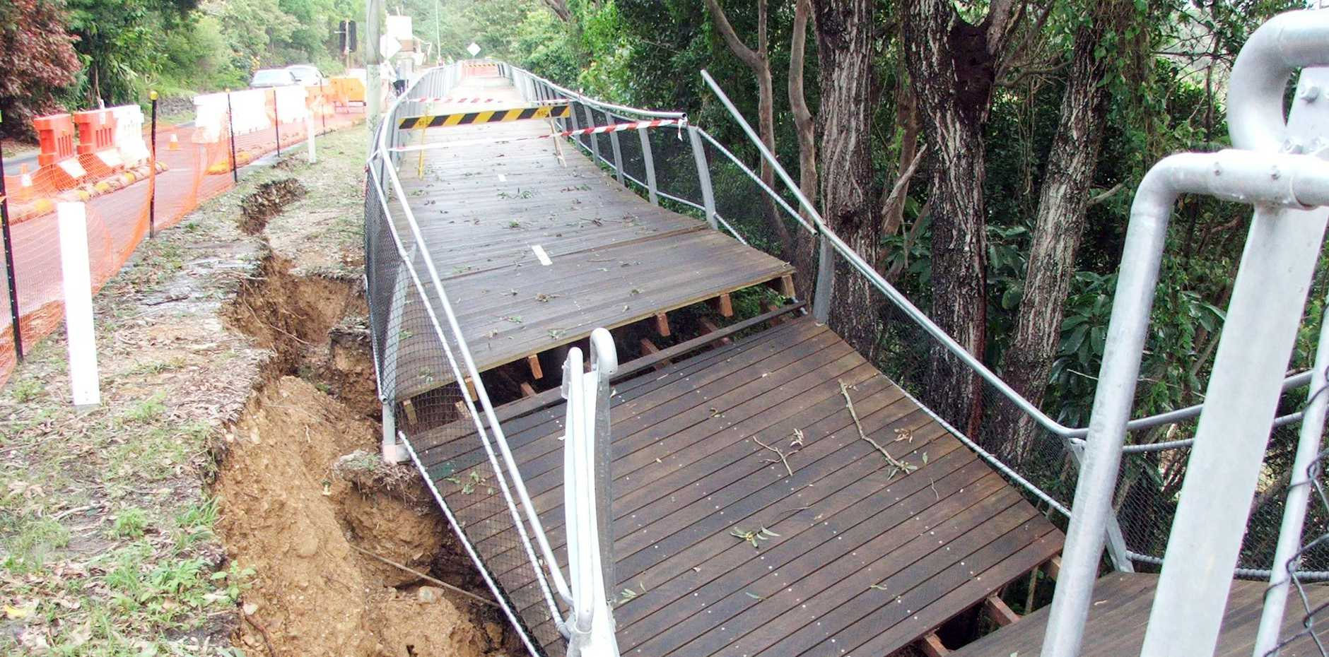 The scene five years ago. The collapsed section of the Lighthouse Road walkway.