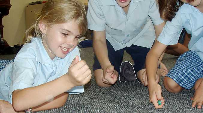 Pupils from St John's Catholic School at Mullumbimby get in some practice for the schools marbles challenge.