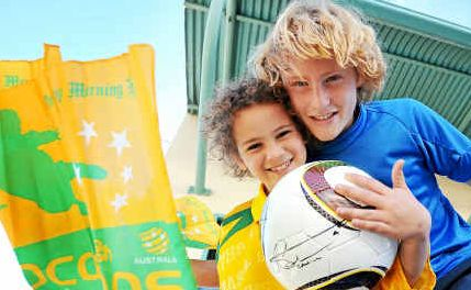 Call to arms: Young Coffs Harbour soccer fanatics Jonah and Noah Bedford with the Tam Cahill-signed World Cup ball.