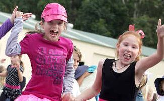Kid rock: Tara Windley, Olivia Sutton and Bradie-Rae Brown, all in Year 2 dance with excitement.