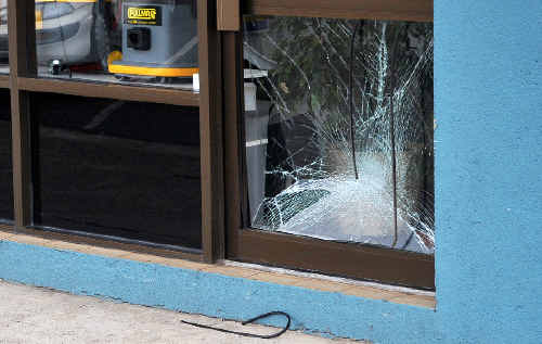 Wrong turn: A glass pane was smashed when a hatchback ploughed into a shopfront yesterday.