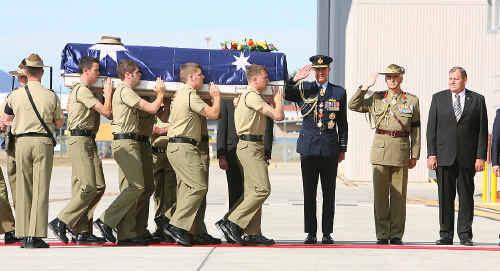 The bodies of Sapper Jacob Moerland and Sapper Darren Smith arrive at RAAF Base Amberley.