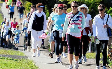 Northern Rivers residents walk the walk down Ballina Street in Goonellabah on Saturday to support Lifeline.