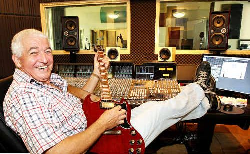 Old rocker Allan Pease plays a tune in his studio.