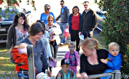 Westlawn Preschool director Fiona Funnell and Member for Clarence Steve Cansdell with the influx of parents into the centre yesterday morning. Mr Cansdell is pushing for 40km/h speed zones around preschools.