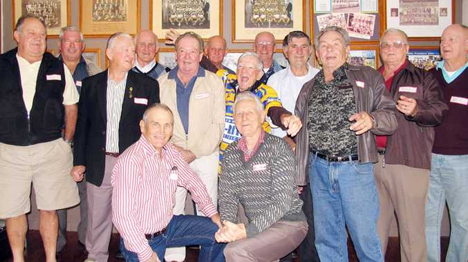 Legendary rugby league coach Ken McMorrow (centre, in jersey) with some of the 1960 champions of the Mullumbimby Rugby League Club, plus club patron Ross Tucker.