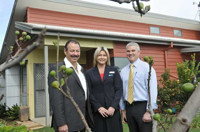 Sustainable Home Toowoomba project officer Louise Mayne (centre) take Cr Peter Marks (left) and Cr Bill Cahill on one last tour of Toowoomba's hugely successful sustainable home project.