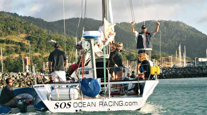 Solo sailor Ian Thomson was greeted by friends who jumped on board as he arrived home at Airlie Beach yesterday afternoon. Photo by Zac Bailey.