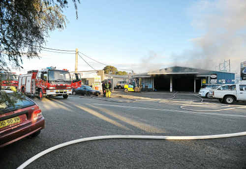 All smoked up: Firefighters battle the blaze that broke out at Marcia Street Wreckers.