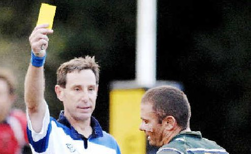 New deal: Versatile referee Graham Cook gives Lismore City's Heath Conlan time to cool his heels with a yellow card in a FNC rugby game last year.