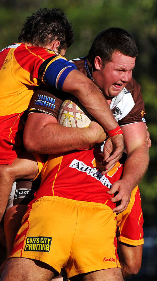 Comet crunch: Enthusiastic Coffs Harbour defence hits the mark.