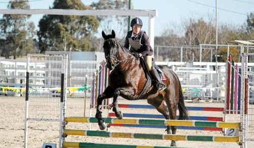 Caitlin Bucknell and Midnight Express go well in showjumping at the Scots PGC Equestrian Extravaganza.