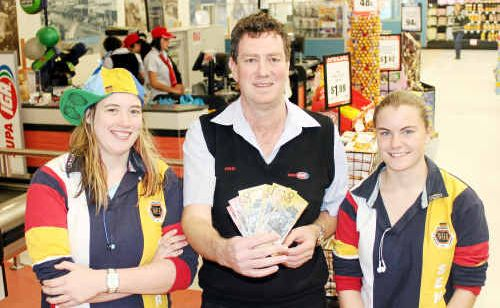 Warwick State High School Year 12 students Jess Pauli (left) and Sian Hegarty with Warwick Supa IGA owner John Hyslop. Warwick State High School is in second position for the $25,000 school cash giveaway.