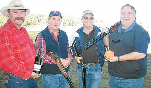 Reaping the rewards of a hard day's clay target shooting were winners (from left) overall high gun Rob Auger, Ray Wingett, Merv Bray and Steve Hall.