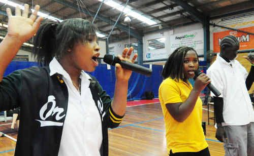 Sisters Robertine and Mary and Panyar rapped to their peers as part of Orara High School's Refugee Week celebrations yesterday.