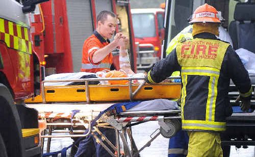 After a one hour rescue the victim of the single vehicle accident on the Bruxner Highway near Richmond Hill Road yesterday (Wednesday) morning clasps the hand of one of the many involved in the rescue.