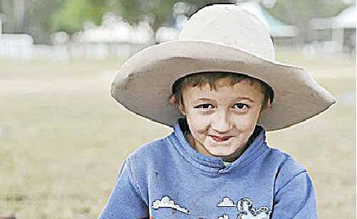 Keagan Young, 6, lending a hand at the Mt Larcom Show.