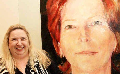 Susi Muddiman with the Julia Gillard portrait at the Tweed Regional Art Gallery.