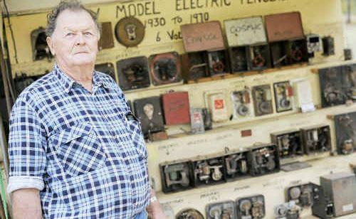 Keven Doessel displaying his collection of antique electric fence chargers at the Mt Larcom Show.