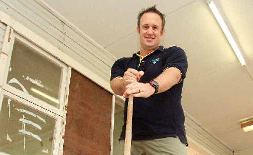 Cabarita Youth Project co-ordinator Matt Cotter gets his hands dirty to combat youth crime.