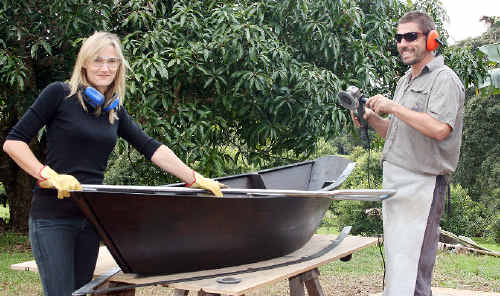 A winner: Dominique Sutton and Sasha Reid work on one of the boats that will be set in a tree for Byron Bay's artsCape.