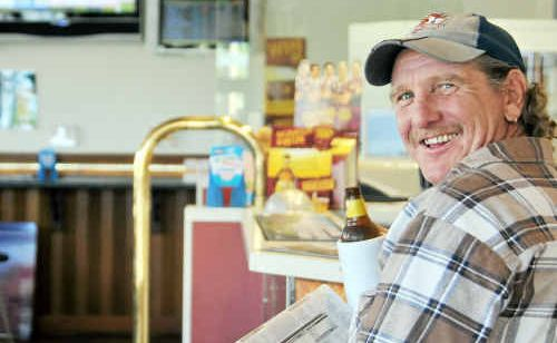 Late-night rugby league sports fan Mick Neevey enjoys a punt on the horses at The Grand Hotel, Goondoon St, Gladstone.