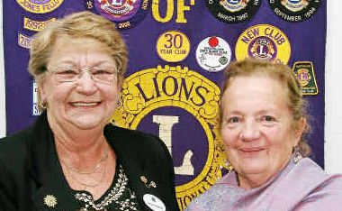 Outgoing Warwick Lions Club president Ros Keim presents Margaret Miller with the Professor Ian Frazer Humanitarian Award for her dedication to the Warwick branch of the Leukaemia Foundation.