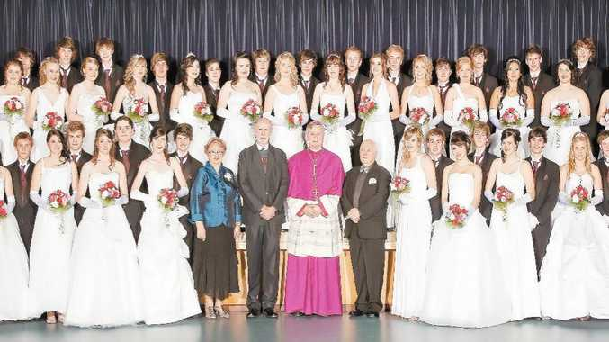 PROUD TRADITION: The young people of Gympie acknowledge the importance of community events like the Catholic Presentation Ball. The 2010 presentees (above)with special guest Bishop Brian Finnigan (centre), Parish Priest Father Pat Cassidy and chaperones for the night, Dave and Meg Connors.
