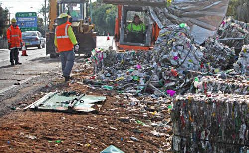The scene Ulmarra residents woke to after a truck rolled on a Pacific Highway bend at the southern end of the village. The scattered debris was the truck's cargo of recycled plastic.