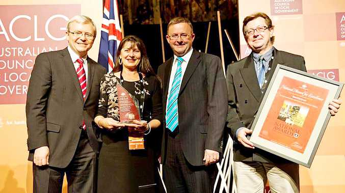 Byron Shire Council mayor Cr Jan Barham and council's environmental officer Michael Bingham (right) accept the Local Government award from former Prime Minister Kevin Rudd and Anthony Albanese MP.