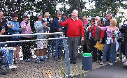 Unhappy anniversary: Byron Bay residents at the Lighthouse Road protest yesterday toast five years since the collapse of the walkway.