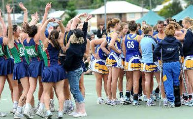 Win some, lose some: Bendigo netballers (at left) celebrate their win over Trinity College in the Australian Marist Carnival grand final in Lismore yesterday.