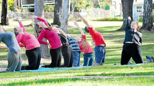 Yoga teacher Lisa Telford gets a class on the go at Moonee.