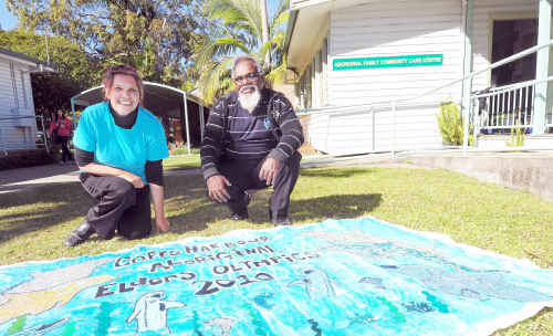Wendy Craig and Kevin Fergusson, social support co-ordinator, and the Coffs Harbour Aboriginal Elders Olympics banner made with eggshells.