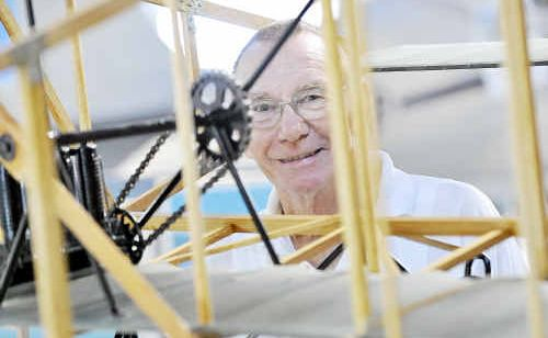 HISTORY: Jim Willson with his scale model of a 1910 Duigan Flyer at Queensland Air Museum.