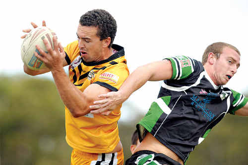 Caloundra's Chris McGill gets the better of Maroochydore's Mick O'Lonnell in the match between the teams in May.