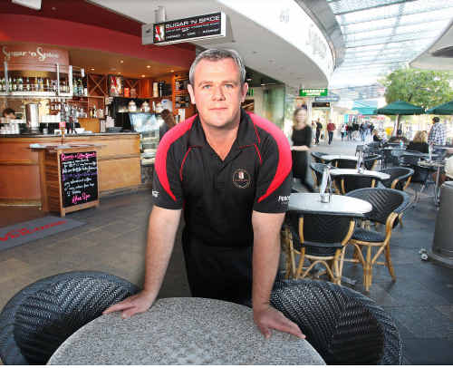Darren Heaton from Sugar n Spice cafe at Mooloolaba is worried about the new conditions employers face which he fears may cause job losses and closures.