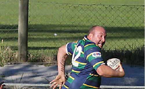 Gentlemen of Murwillumbah player Mike Ford zips clear in the 34-15 win over Iluka on Saturday.