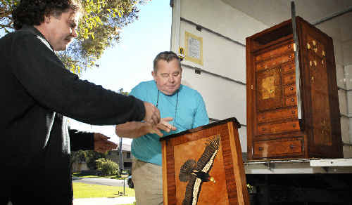 Lismore master craftsman Geoff Hannah (right) and student Gary Shallala-Hudsonload the dismantled Hannah Cabinet on to a truck before transporting it to Sydney.