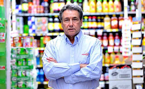 Sunshine Coast businessman Mel Luke is in the midst of a David-and-Goliath battle with Wesfarmers-Coles after it bought the Coolum Village Shopping Centre that houses one of Mr Luke's supermarkets.
