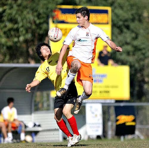 Sunshine Coast Fire's Yuta Gonai, left, contests possession as they head towards a win.