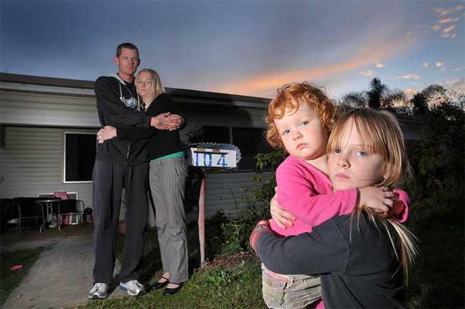 Amanda Volkers, Chris Seath and their children Ella, 3, and Jade, 8.